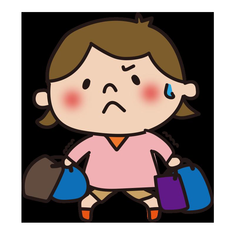 重い荷物を持つ女の子