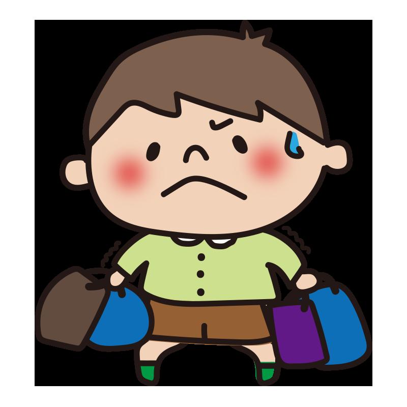 重い荷物を持つ男の子