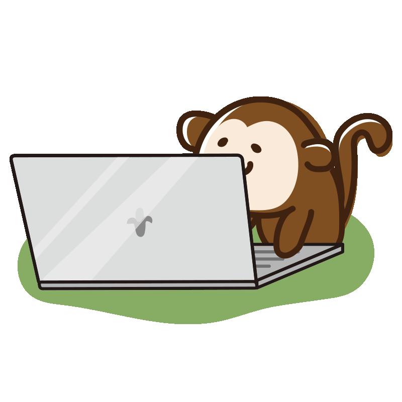 ノートパソコンを開くサル