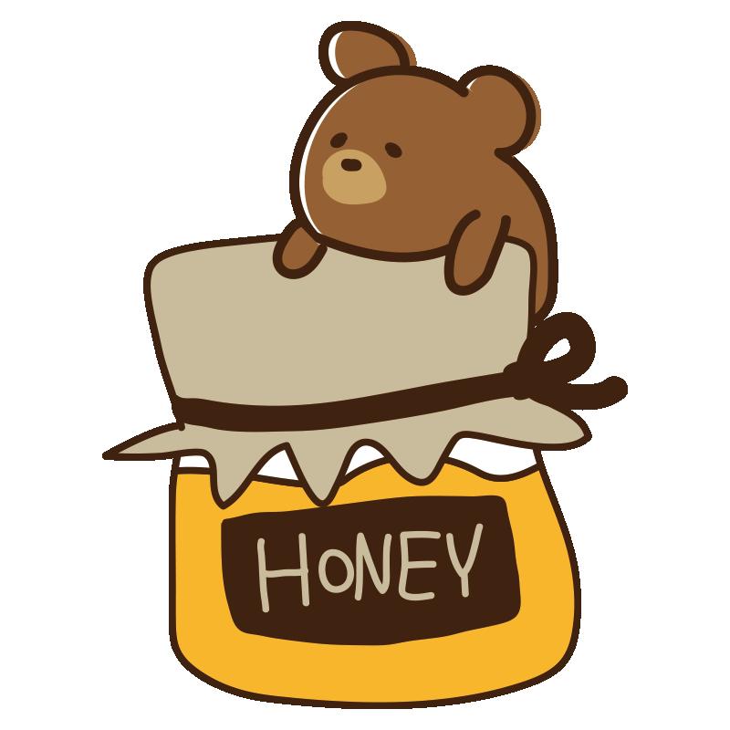 蜂蜜のボトルとクマ