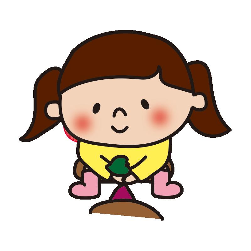 お芋掘りする女の子