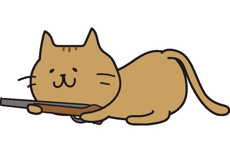 低い姿勢で銃を構えている茶色い猫